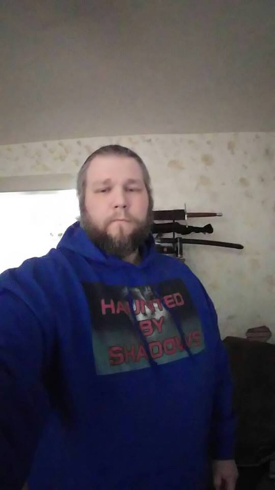 A fan wearing one of the hoodies from the shop